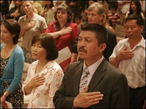Xiangqing Sun, formerly of China and now of Genoa, Sang Ye Warner, formerly of South Korea and now of Clyde, and Jesus Alberto Guel, formerly of Mexico and now of Toledo, become U.S. citizens in Toledo.