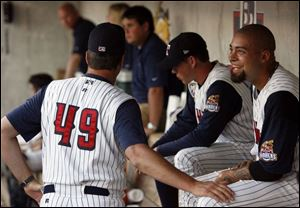 Mud Hens pitching coach A.J. Sager (49) talks with Joel Zumaya between the seventh and eighth innings last night at Fifth Third Field. Zumaya, in Toledo on a rehab assignment, threw 34 pitches.