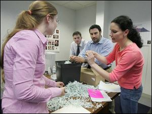 New central committee Chairman Meghan Gallagher, left,