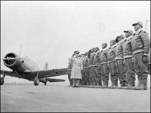 This Jan. 23, 1942 photograph provided by the U.S. Army Signal Corps shows Major James Ellison, left, inspecting the air cadets in training at Tuskegee Institute in Tuskegee, Ala.