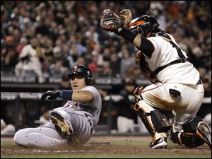 Detroit Tigers' Miguel Cabrera, left, is tagged out at home plate by San Francisco Giants catcher Bengie Molina during the seventh inning Tuesday, in San Francisco. Cabrera attempted to score on a single by Ivan Rodriguez.