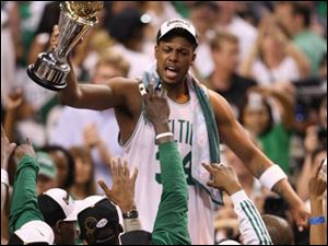 Paul Pierce holds his NBA finals MVP trophy after the Celtics whipped the Lakers for their first title since 1986.