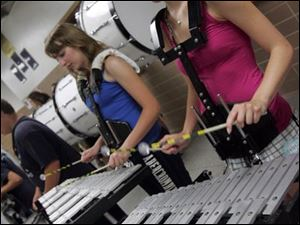 Shannon Novin, left, and Danyna Ferguson play the bells.