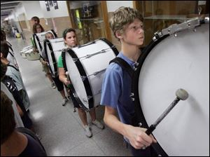 Jerin D'Anniballe beats his drum during band practice at Clay High School in Oregon. The students in the high school's marching band keep the beat alive for the school, and musicians start learning in fifth grade. The band travels every other year. In April, the band marched down Main Street at Disney World.