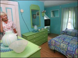 Pamela Shay, owner of Pamela Shay Angel Arms Family group home, looks at the room that Joh