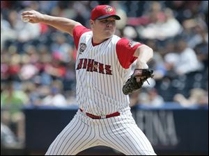 Blaine Neal pitches Tuesday against Syracuse when he picked up his 20th save. The 13-year veteran is hoping to get back to the major leagues for the first time since 2005.