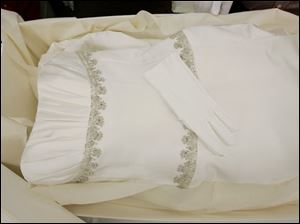 White gloves are left on a preserved and boxed wedding dress at Hallak Cleaners Friday, May 30, 2008, in Hackensack, N.J. The gloves are left in case the owner might want to handle the dress. 