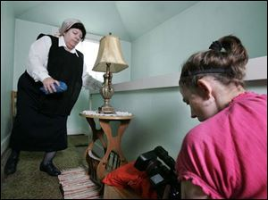 Camera operator Lynn King videotapes Sister Pam Nosbusch inside St. Agnes Convent on Martha Street. The scene depicts the nun hiding religious items as part of a documentary about Catholic nuns who were persecuted in Eastern European countries under Soviet rule. (THE BLADE/DAVE ZAPOTOSKY)