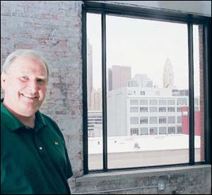 Jack Hoopes, a developer with Columbus Spectrum Properties, hopes the view of downtown Columbus from this empty CityView at 3rd condominium will attract a buyer.
