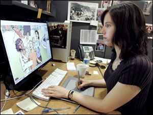 Erika Stiskal polishes a computer illustration at Root Learning, which was praised for creative excellence.