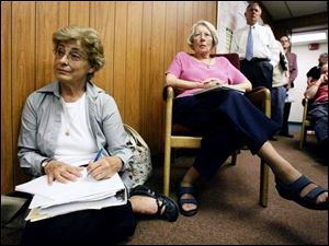 Jackie Fletcher, on floor, and Mary Lewis, supporters of saving the 1884 courthouse from demolition,