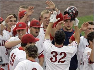 Teammates greet Fresno State s Tommy Mendonca (32) after