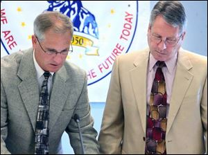 Anthony Wayne Local School District Superintendent John Granger, left, and board President Don Atkinson confer at the district administration building in Whitehouse. The district is asking voters to approve two levy requests on the ballot. If passed, the measures would increase annual revenue by $6 million.