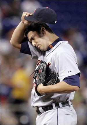The Tigers  Armando Galarraga composes himself after giving up an RBI single to the Twins  Joe Mauer in the fifth inning.