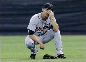 Tigers right fielder Ryan Raburn can't believe the umpires ruled his attempt to make a diving catch in the sixth a trap.