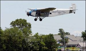 The Ford Tri-Motor heads back to the airport after a passenger flight. Island Airlines used the planes from 1936 to 1986.