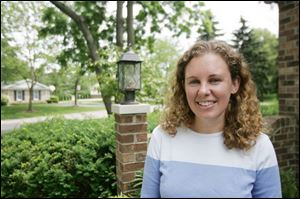 Andrea Messmer, 31, is visiting her parents in Ottawa Hills on a 12-day vacation from her Peace Corps work in Cambodia.