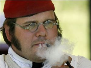 D.J. Tripp of Fort Madison, Iowa, enjoys his pipe. He and his group traveled almost 500 miles to get to Perrysburg.