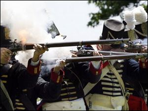 Re-enactors with Cushing's Company, 2nd Regiment fire for 'civilians' at the 1813 Independence Celebration at Fort Meigs.