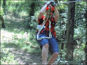 A visitor sails through the treetops