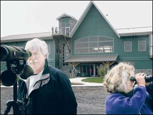 Visitors drawn to the Ottawa National Wildlife Refuge have included Olympia, Wash. s Tom Schooley and Sheila McCartan.