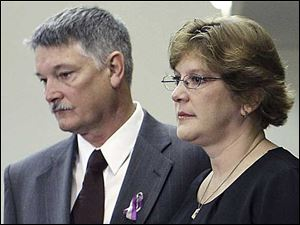 From left, Barry and Lynn Mesley, parents of James Hausman who was injured in the crash, take