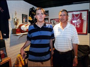 Jamie Mercurio, left, with his father, Jim, stands in front of some of the athletic awards and memorablia from Jamie's career. One of Jamie Mercurio's most productive games was a 1992 NCAA tournament match-up against North Carolina when he made eight 3-pointers and led Miami with 24 points.