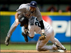 The Tigers' Placido Polanco gets taken out by Adrian Beltre while trying to turn a double play in the seventh inning.