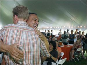 Outgoing BGSU President Sidney Ribeau hugs Mike Marsh at the farewell picnic. Mr. Ribeau arrived in 1995.