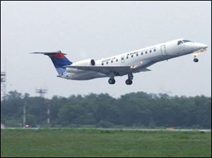 An Embraer ERJ-135 takes off. After Sept. 2 all Delta flights will be gone, leaving Toledo Express with just three carriers