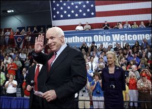Republican presidential candidate John McCain, with his wife, Cindy, right, greets supporters during a campaign stop at the Portsmouth High School gym in southern Ohio.