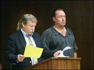 Thomas Bragg, 46, right, accused of felonious assault and attempt to commit an offense, appears with his public defender, James MacHarg, in Toledo Municipal Court yesterday.