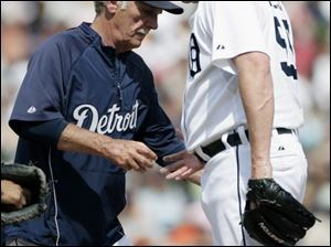 Tigers manager Jim Leyland takes ball from an apparently 