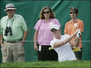 Toledo native Stacy Lewis intently watches her ball from a sand trap on No. 9 in the opening round. She shot a 1-under 70.