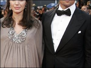 "American actress Angelina Jolie and American actor Brad Pitt arrive for the premiere of the film ""Changeling"" at the 61st international Cannes film festival, on Tuesday, May 20, 2008."