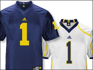 Made by adidas, which contracted with UM on an eight-year, $60 million licensing agreement last year, the home jersey appears to largely stick with tradition. They're the familiar blue with solid maize numbers. But a key difference in the Wolverines' road White jerseys is the maize stripe running from the neckline to the front of the shoulder and down the sleeve on the left and right sides.