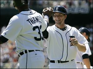 Clete Thomas, right, hit his first major league home run, a tworun-shot, and is congratulated by Marcus Thames.