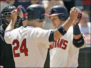 Cleveland s Grady Sizemore (24) and Jhonny Peralta