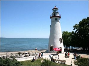The Marblehead Lighthouse and picturesque lakefront draw vacationers looking to kick back and relax.