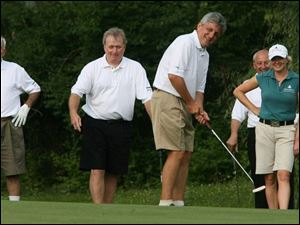 Jamie Farr, left, Jim Murray, Gary Benz, Alan Brass, and pro golfer Mhairi McKay enjoy the Toledo Edison/ProMedica Health System Pro-Am.