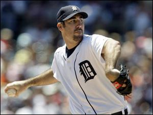 ABOVE: The Tigers' Justin Verlander fanned eight and allowed four hits to defeat Minnesota yesterday at Comerica Park.