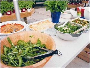 Salads and home-cooked dishes were served at the Slow Food Maumee Valley June potluck.