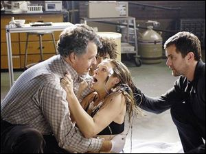 Walter Bishop (John Noble), left, and Peter Bishop (Josh Jackson) try to calm a hysterical woman (Jasika Nicole) in the premiere of Fringe. Olivia Dunham (Anna Torv) is partially obscured behind Walter Bishop.