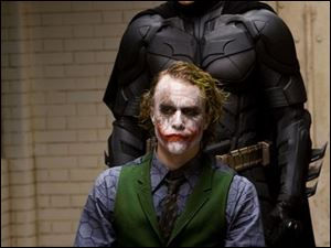 Christian Bale, above, as Batman and Heath Ledger as the Joker in The Dark Knight.