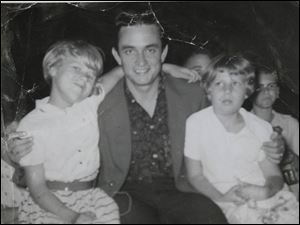 Young Sharon Chinni, right, and her sister, Linda Lutes, with Johnny Cash.