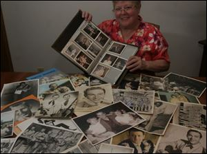 Sharon Chinni with photos and memorabilia of country artists.