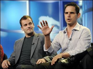 Eli Stone star Jonny Lee Miller, left, listens as executive producer Greg Berlanti discusses the second season of the show.