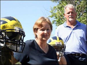 Pam and Jewel Threet have been UM football season-ticket holders for years. Their son, Steven, most likely will be the starting quarterback when the Wolverines open the season.