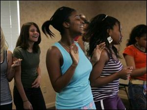 From left rear, Taylor Heer, 15, and Jessica Monosmith, 13, and, front left, Kennedy Haithcock, 14, Chanelle Carr, 13, and Aspen White, 11, rehearse for the upcoming video.