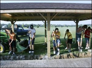 Glandorf teens volunteer their time at a new park shelter.